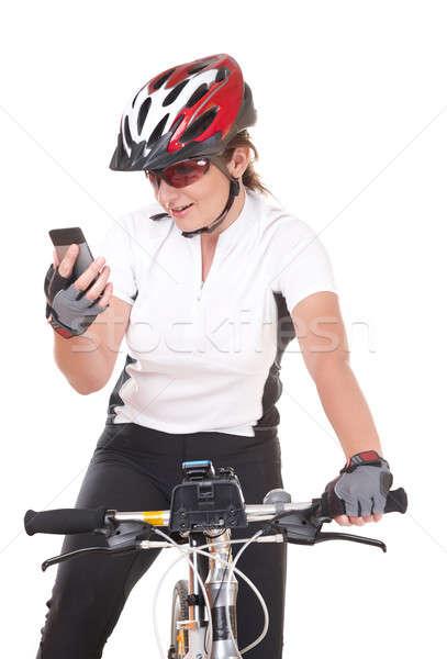 Lány kerékpáros beszél telefon fiatal nő motoros Stock fotó © Amaviael
