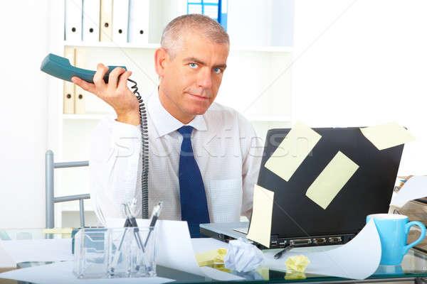 Empresario sesión escritorio maduro Foto stock © Amaviael