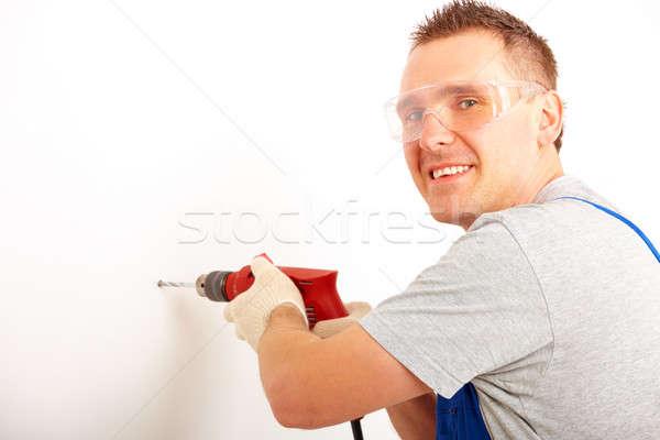 Man drilling hole Stock photo © Amaviael
