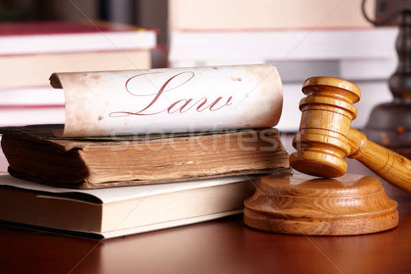 Judges gavel with very old books Stock photo © Amaviael