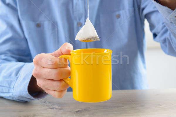 Foto stock: Chá · saco · copo · caneca · mão · comida