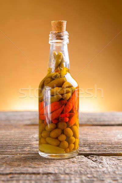Marinaded chili peppers Stock photo © Amaviael