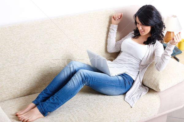 Güzel bir kadın netbook'lar kanepe portre oturma Stok fotoğraf © Amaviael
