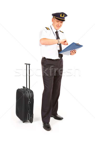 Airline pilot checking time Stock photo © Amaviael