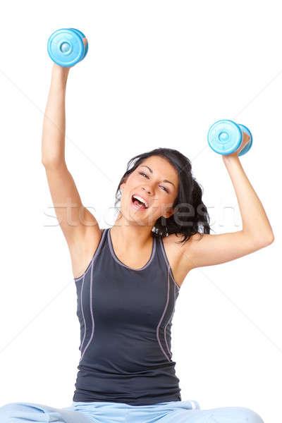 Jonge vrouw oefening stom bel armen Stockfoto © Amaviael