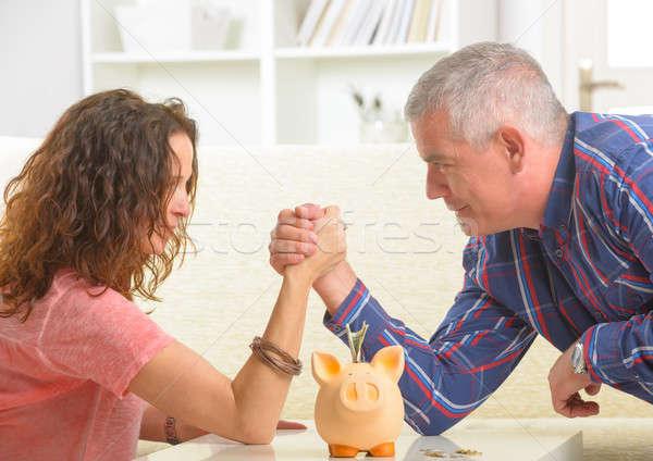 Couple doing armwrestling Stock photo © Amaviael