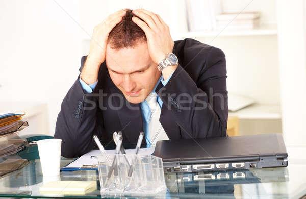 Stressed businessman sitting at desk Stock photo © Amaviael