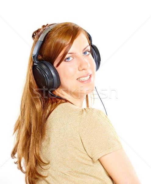 Menina fones de ouvido olhando de volta isolado branco Foto stock © Amaviael