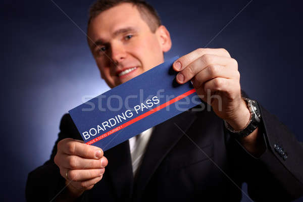Business man holding a boarding pass  Stock photo © Amaviael