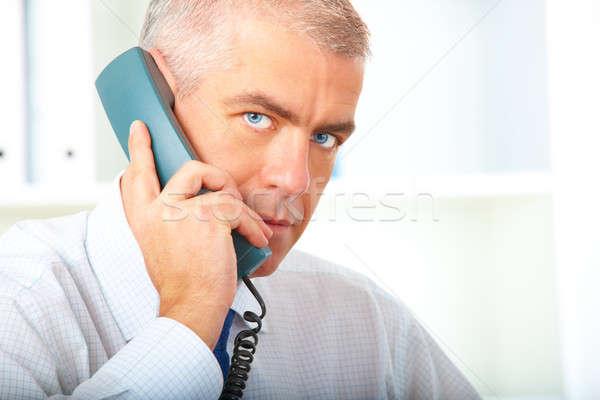 Empresario teléfono maduro oficina trabajo hombres Foto stock © Amaviael