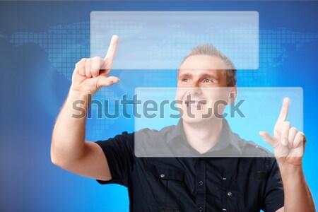 Człowiek wskazując coś puszka działalności Zdjęcia stock © Amaviael