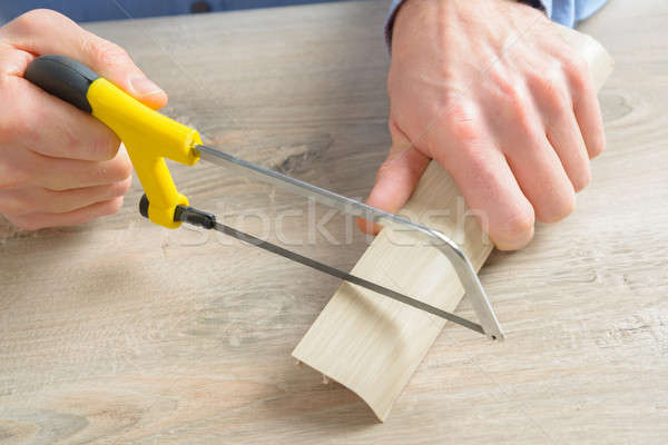Cutting plastic molding with handsaw Stock photo © Amaviael