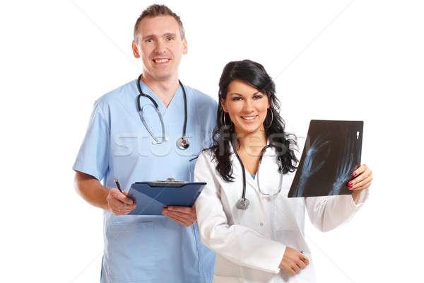 Foto stock: Dos · médicos · mirando · paciente · Xray · feliz