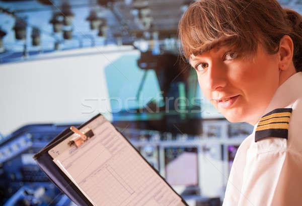 Légitársaság pilóta gyönyörű nő visel egyenruha headset Stock fotó © Amaviael
