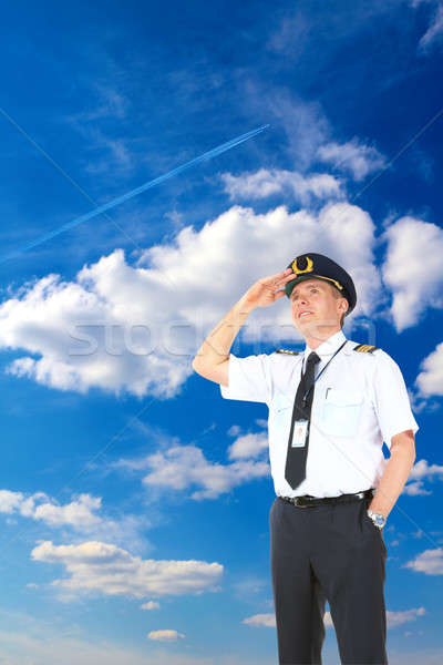 Stock photo: Airline pilot looking upwards