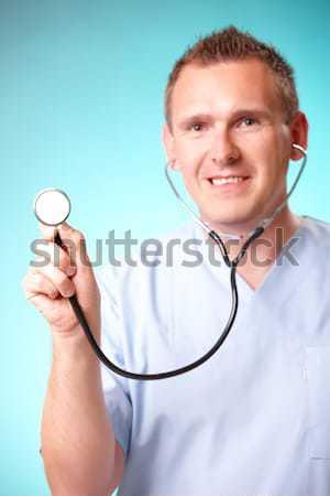 Alegre médico sorridente médico estetoscópio isolado Foto stock © Amaviael