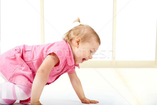 Cute baby girl crawling Stock photo © Amaviael