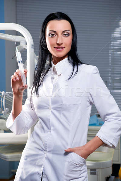 Attractive woman with medical syringe  Stock photo © amok