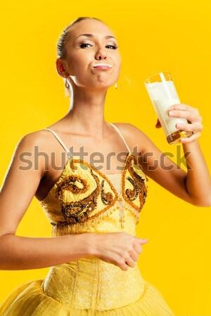 Smiling ballerina in yellow tutu holding pointe shoes Stock photo © amok