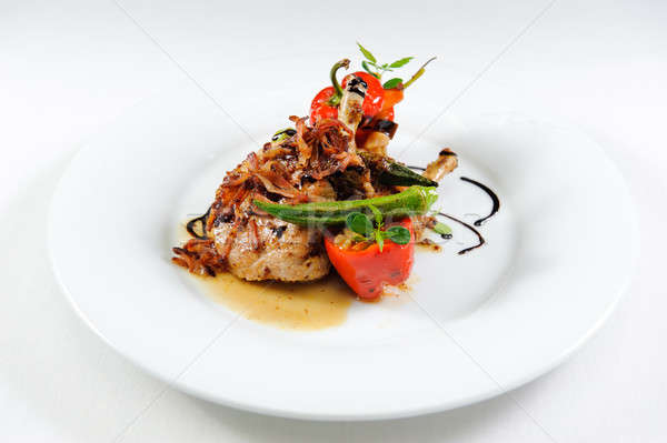 Grilled pork chop flamed in gin with sweet and sour vegetable ra Stock photo © amok