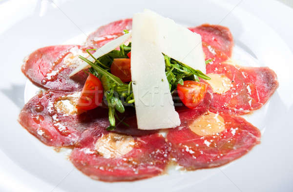 Meat carpaccio with parmesan cheese, tomatoes and herbs Stock photo © amok
