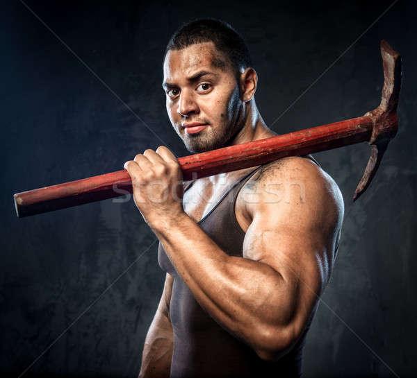 Muscular man holding pickaxe Stock photo © amok