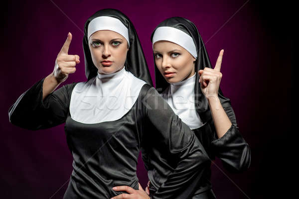 Attractive young nuns posing indoors Stock photo © amok