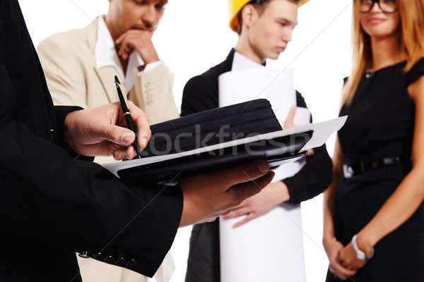 Construction team at business meeting signing a document Stock photo © amok
