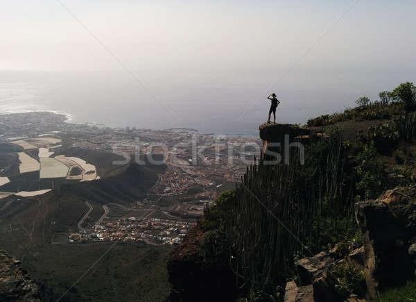 Woman on a edge of a mountain enjoying valley view Stock photo © amok