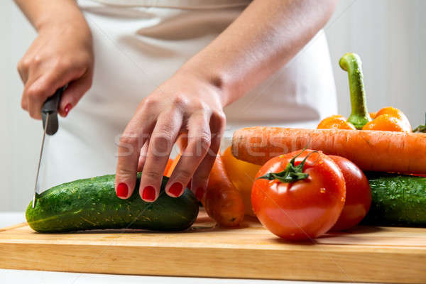 Woman cutting vegetables for a salad Stock photo © amok