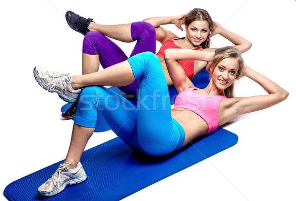 Due bella ragazze addominale esercizio bianco Foto d'archivio © amok