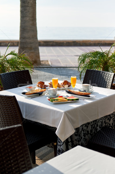 Outdoors restaurant. Table setting with classic breakfast. Stock photo © amok