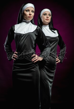 Two attractive sexy nuns posing indoors Stock photo © amok