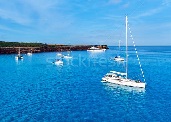 Early morning in in Formentera. Sailboats at Cala Saona bay Stock photo © amok