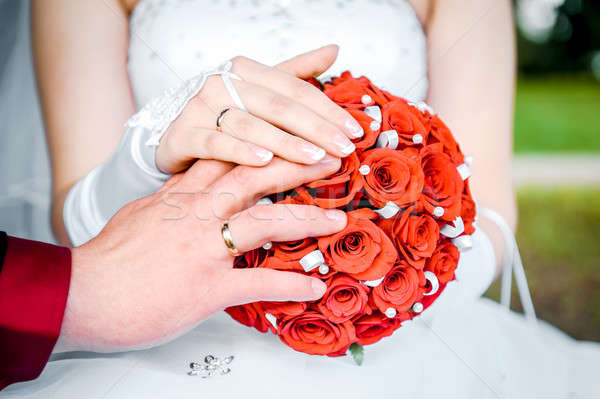 Hands of the bride and groom and bridal bouquet close-up Stock photo © amok