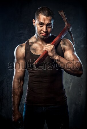 Muscular young man with jackhammer posing over grey background Stock photo © amok
