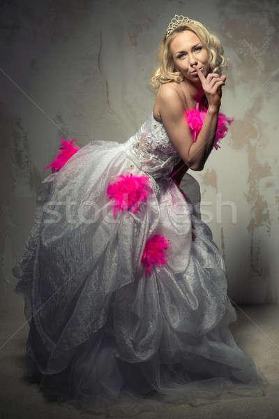 Beautiful woman in wedding dress making a hush gesture Stock photo © amok