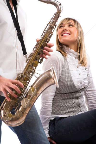 Man plays the saxophone for lovely girlfriend Stock photo © amok