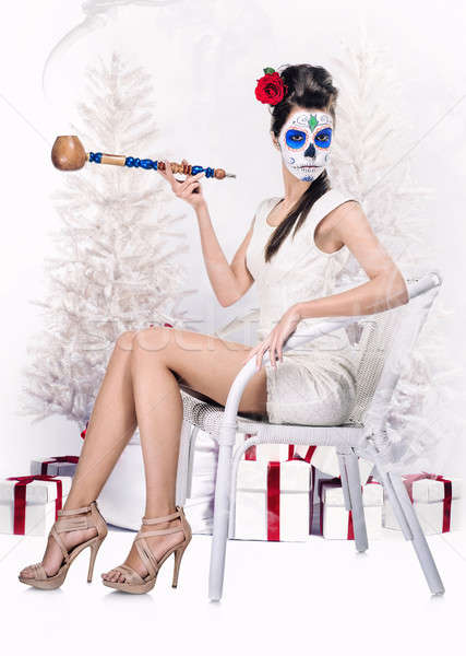 Day of the dead girl with tobacco pipe over christmas background Stock photo © amok