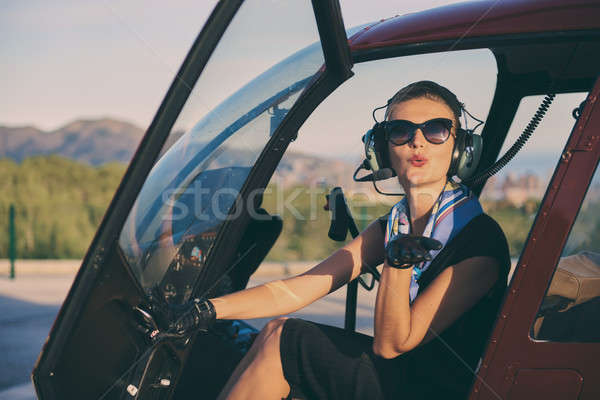 Attractive woman pilot sitting in the helicopter Stock photo © amok