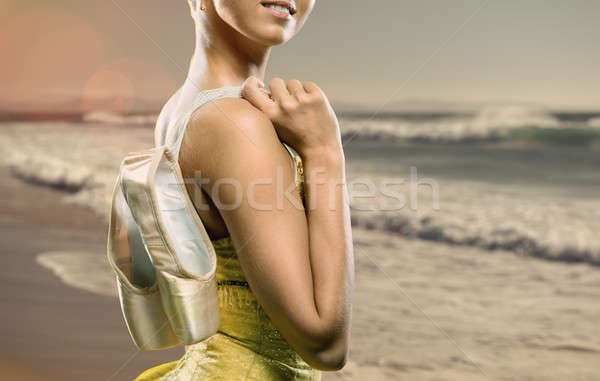 Ballerina with pointe shoes against ocean background Stock photo © amok