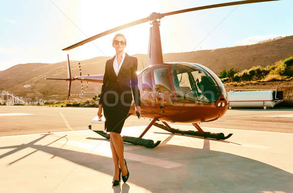Elegant business woman near the helicopter. Stock photo © amok