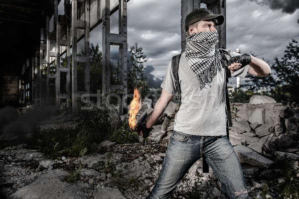 Man with Molotov cocktail Stock photo © amok