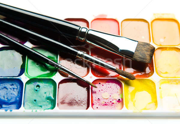 Watercolor paintbox and paintbrushes close-up Stock photo © amok