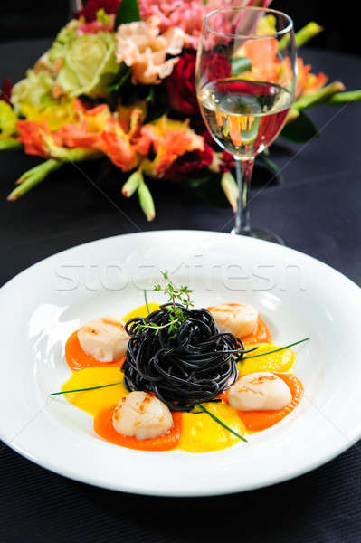 Black pasta with meat, garnished with sauce and  herbs close-up Stock photo © amok