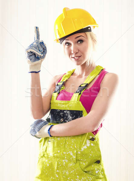 Female wearing coverall and hard hat posing indoors Stock photo © amok