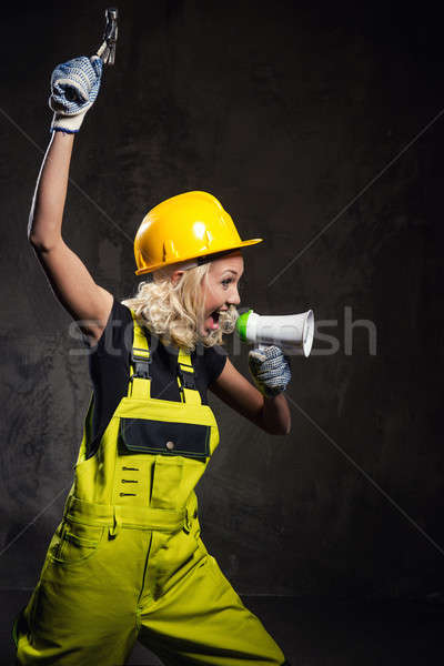 Attractive builder woman shouting through megaphone Stock photo © amok