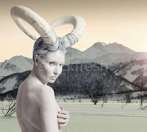 Female with goat body-art over winter countryside background Stock photo © amok