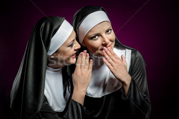 Young attractive nun whispering a secret to another nun  Stock photo © amok