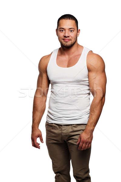 Muscular build young man isolated on white background Stock photo © amok